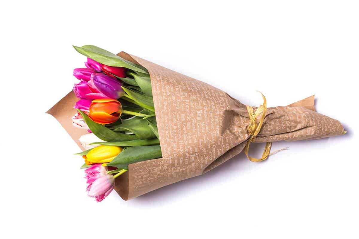 Bouquet-of-spring-tulips-flowers-wrapped-in-paper-bag