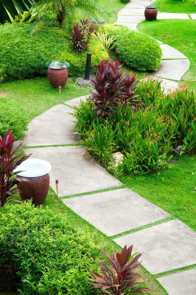 Concrete path through a green garden