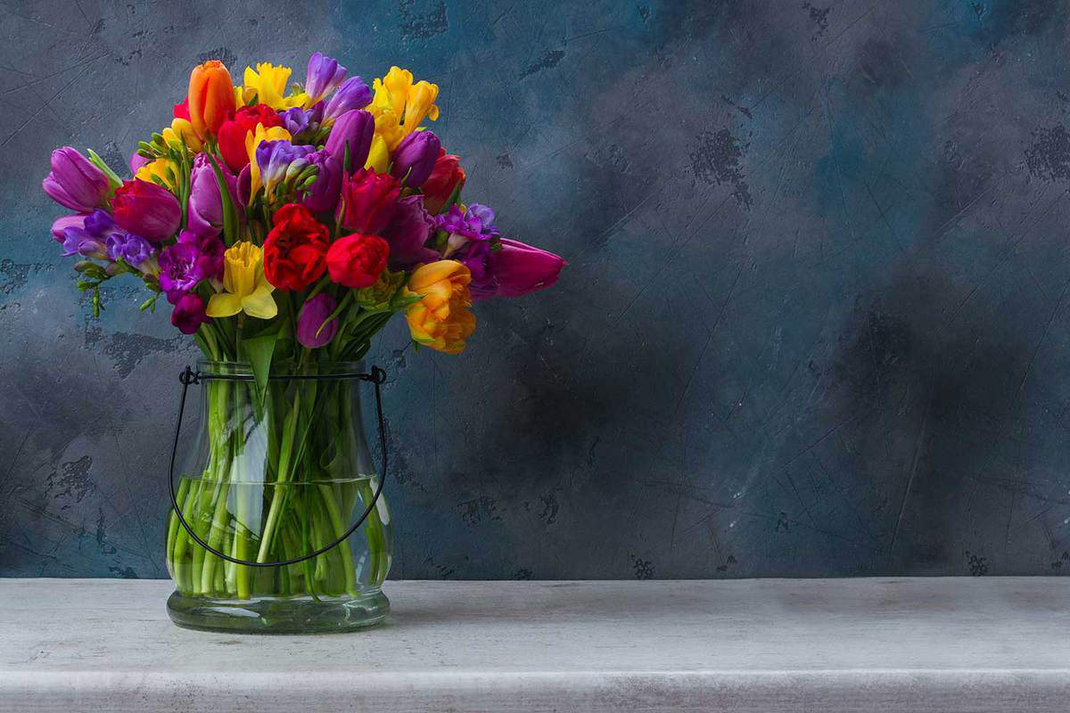 Glass-of-bright-spring-flowers
