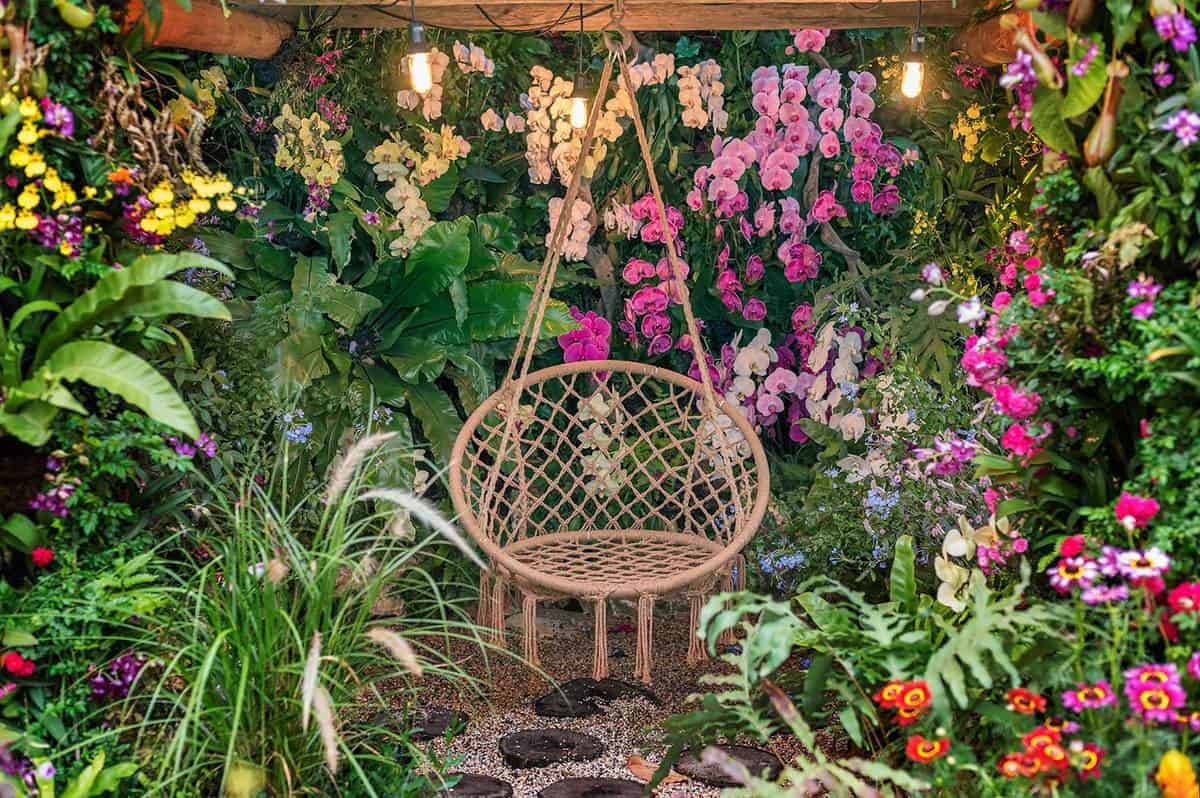 Seat in backyard flower garden