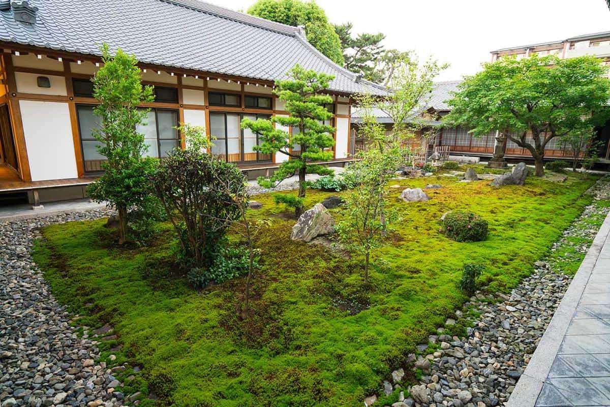 Small zen garden between temple walls in japan