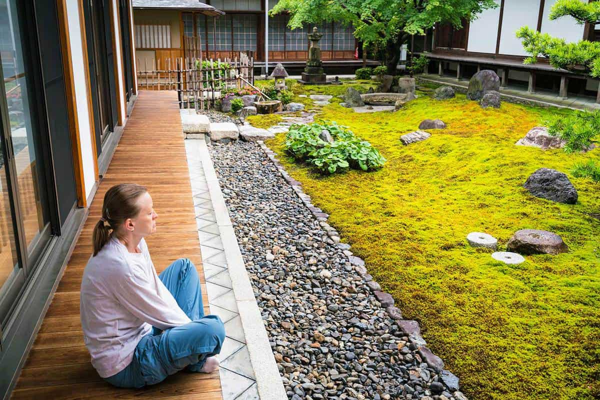 Woman and zen garden of a temple
