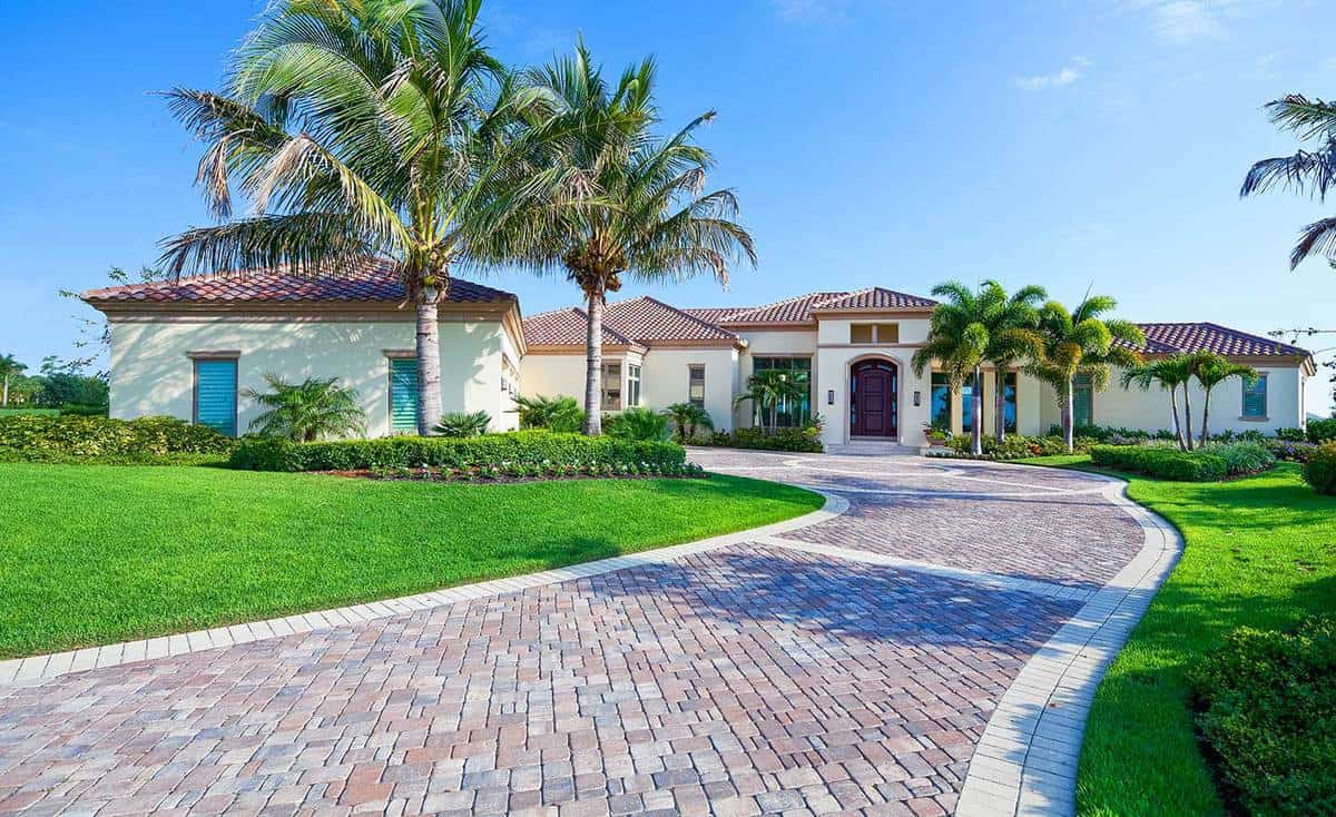 A paver driveway leads to a beautiful estate home in Florida