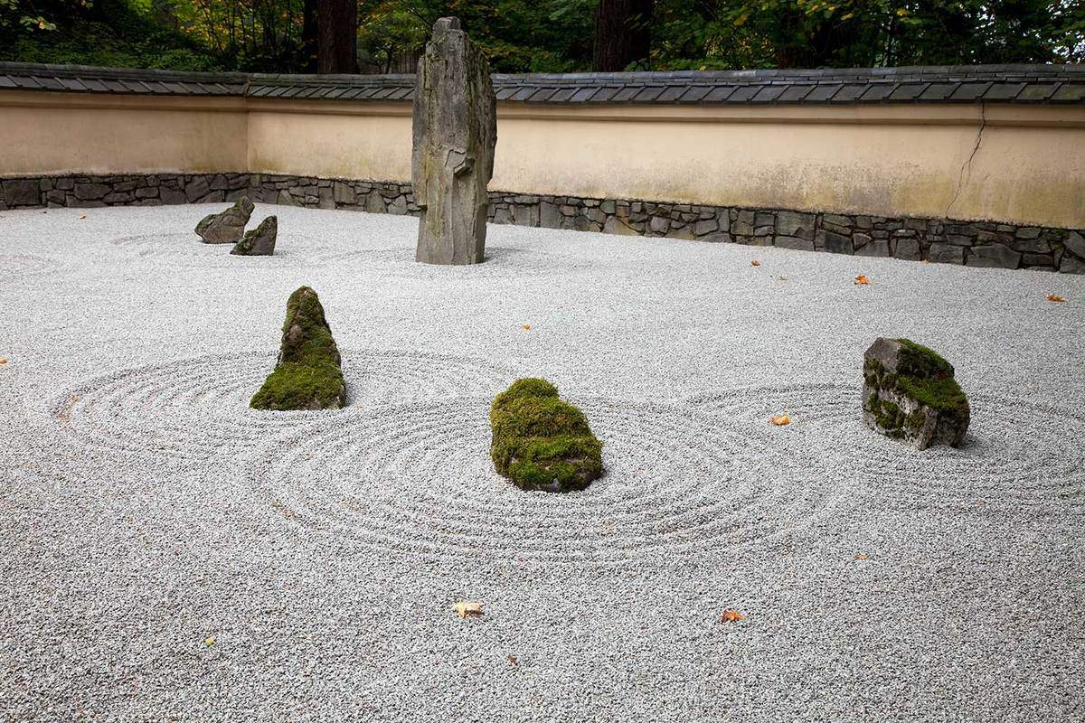 Japanese zen garden with sand and stone