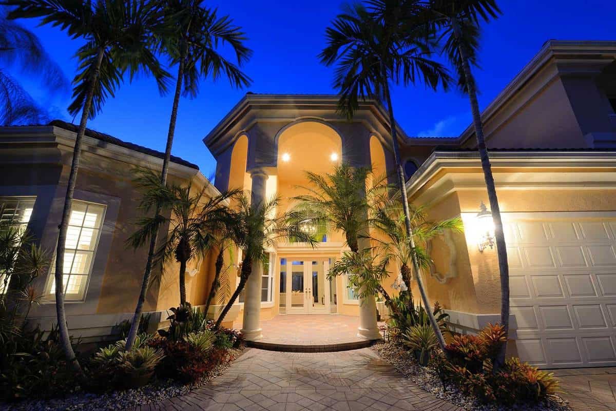 Mansion entrance in a tropical location during night time