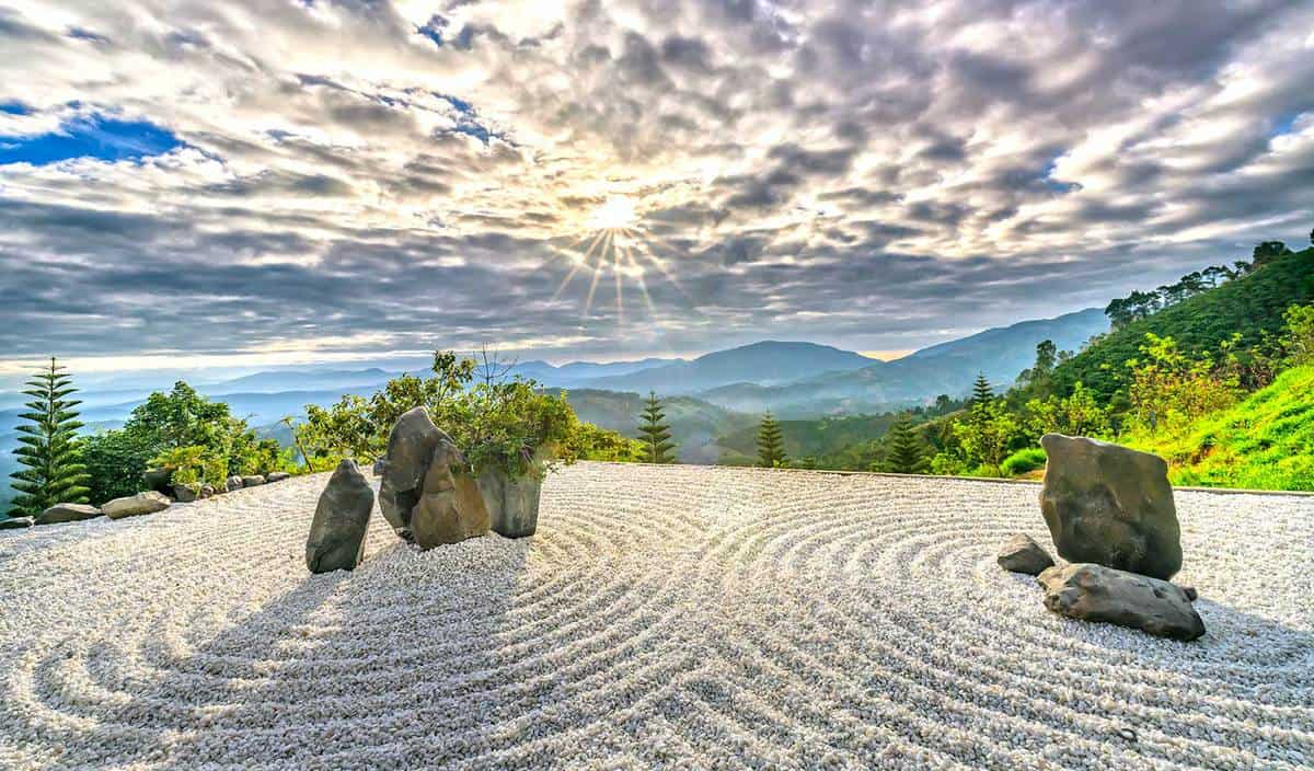 Zen rock garden with the rays of sunshine radiating in the sky