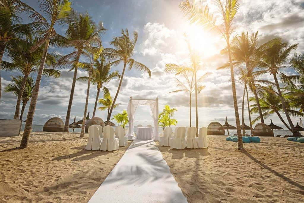 Romantic wedding under palm trees on the white beach