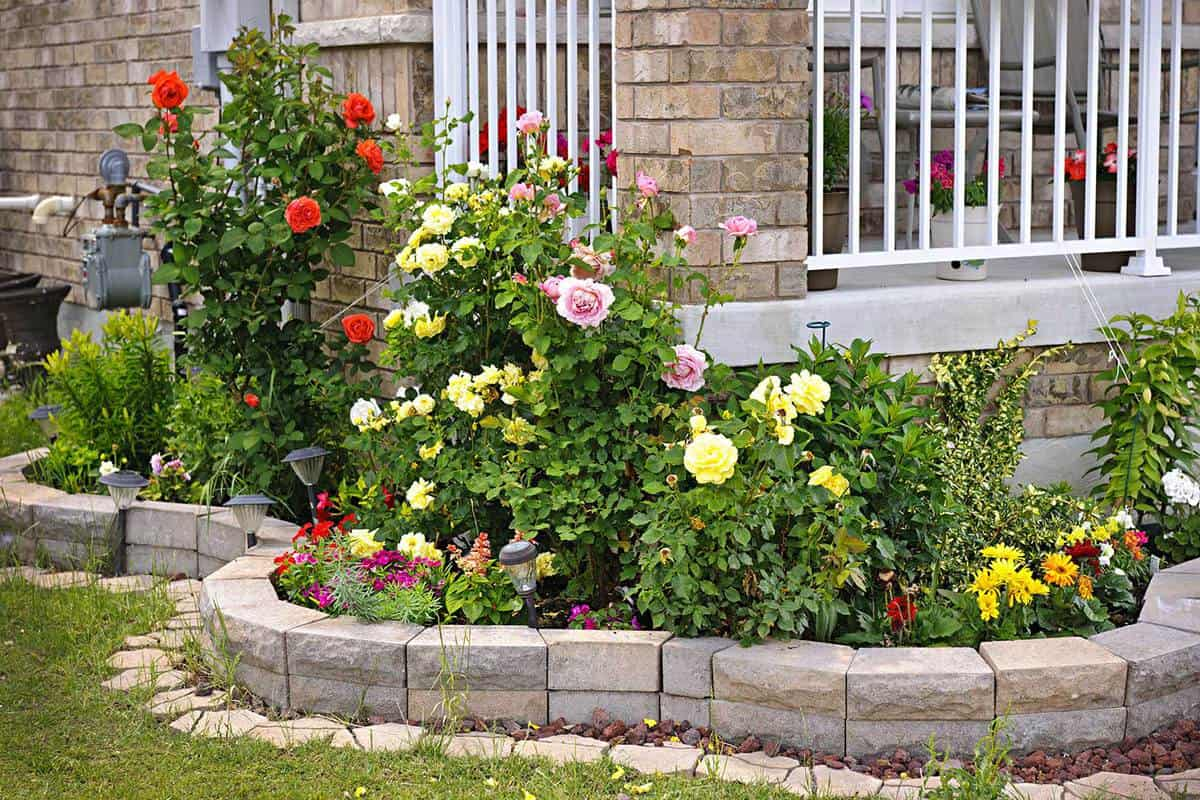 Natural stone landscaping in home rose garden