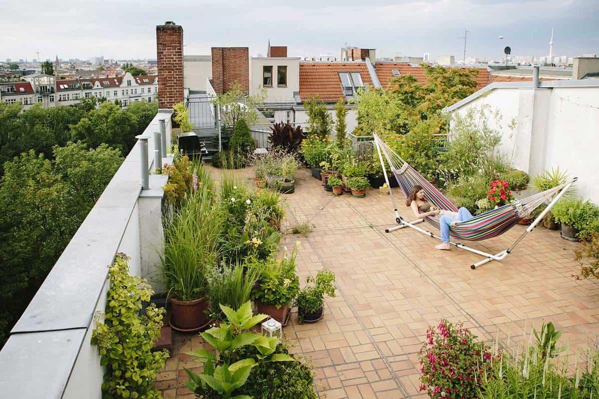 Relaxing urban roof garden with hammock