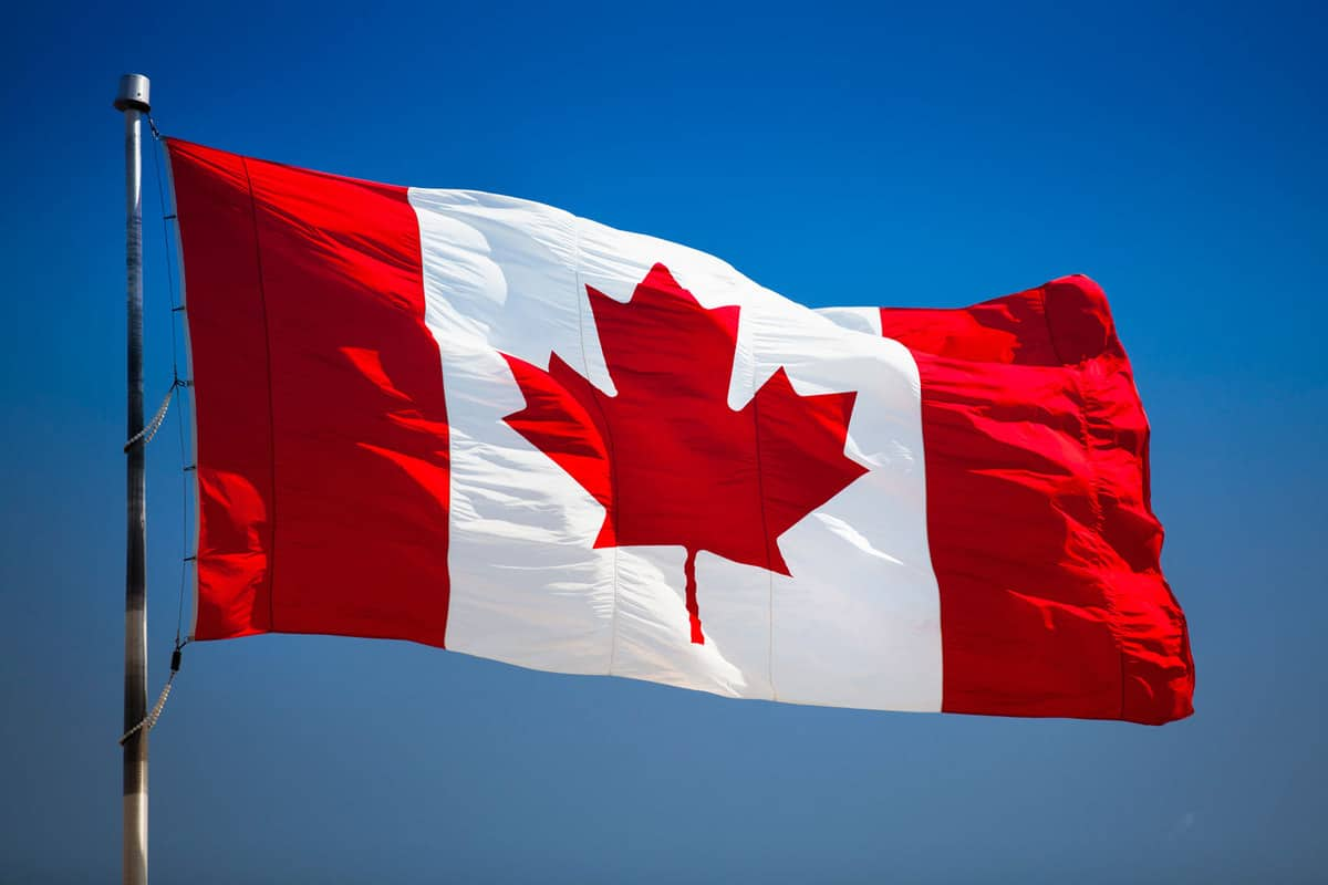 Maple leaf flag flying in the wind