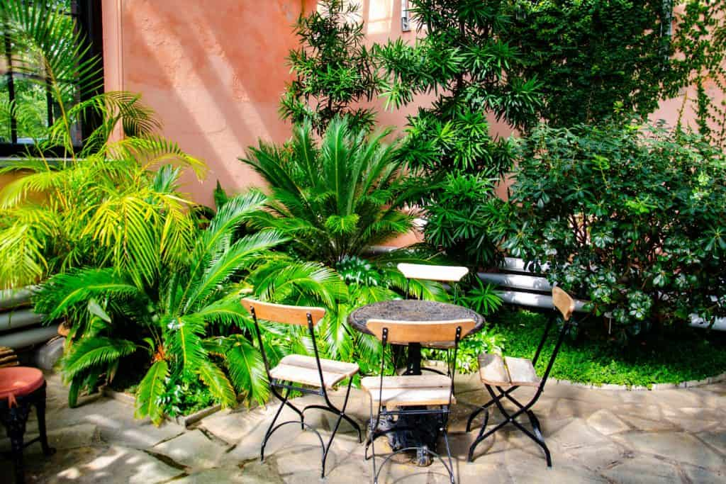 A gorgeous and modern garden patio with chairs and tables