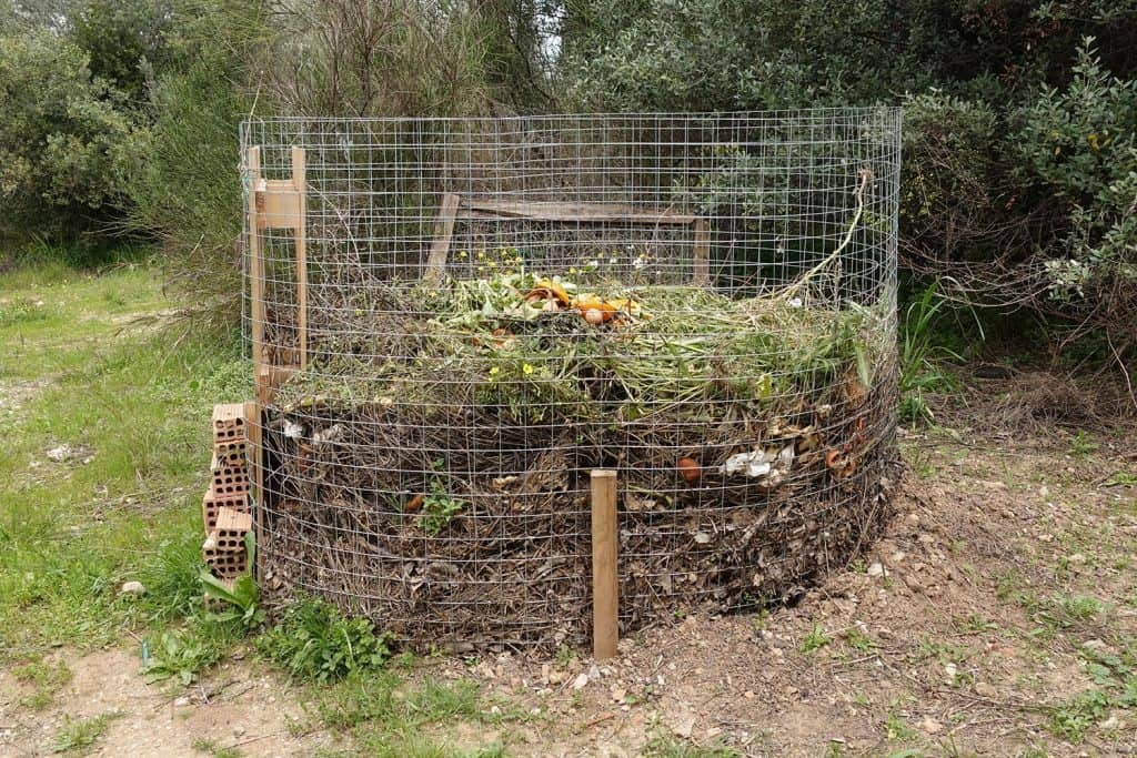 Compost pile with leaves branches food leftovers and other organic waste