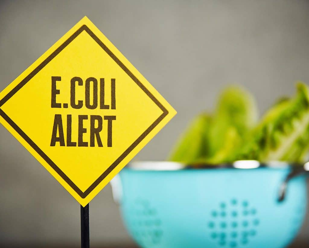 Lettuce in bowl with health warning