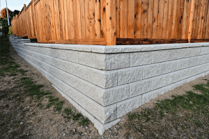 Read more about the article Should You Add A Fence To A Retaining Wall? [And How To Do So]