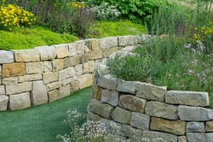 Read more about the article Does A Retaining Wall Stop Water? [And How To Add Drainage]