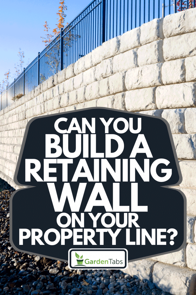 A corner view of a precast cement block retaining wall, Can You Build A Retaining Wall On Your Property Line?