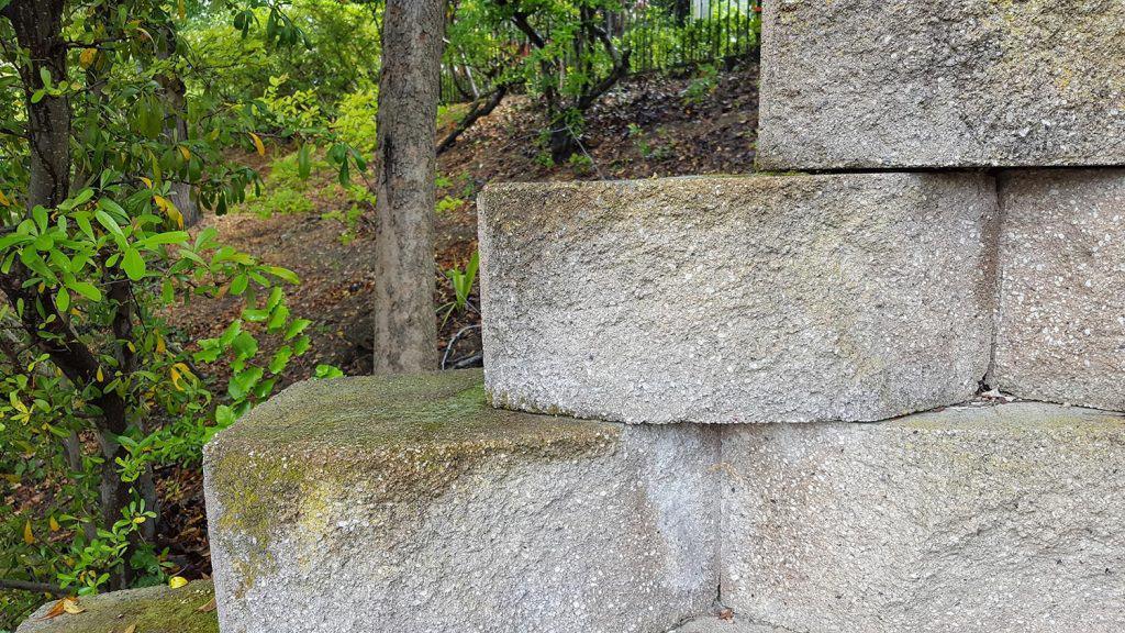 Concrete retaining wall dividing the frame diagonally