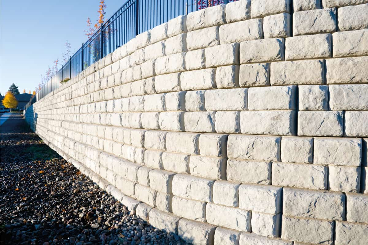 Corner view of a precast cement block retaining wall showing texture detail.