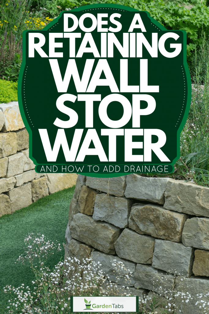 A gorgeous retaining wall using square marble rock and flowers on top for landscaping purposes, Does A Retaining Wall Stop Water? [And How To Add Drainage]