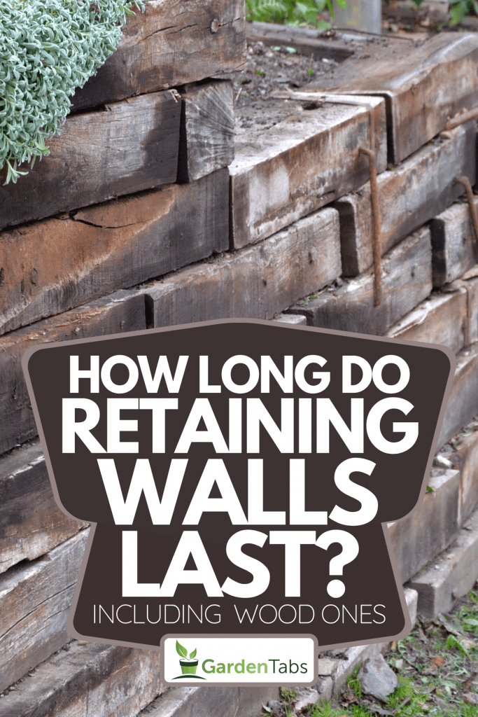 A retaining wall made of wooden sleepers, How Long Do Retaining Walls Last? [Inc. Wood Ones]