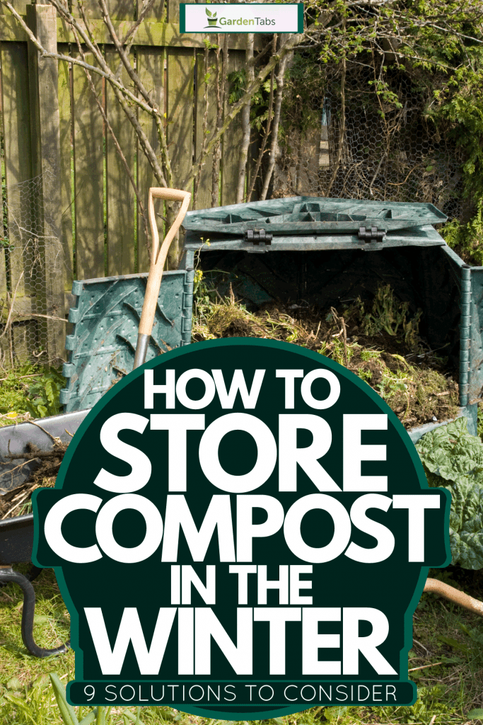 A compost bin with a wheel barrow on the side with a shovel, How To Store Compost In The Winter [9 Solutions To Consider]