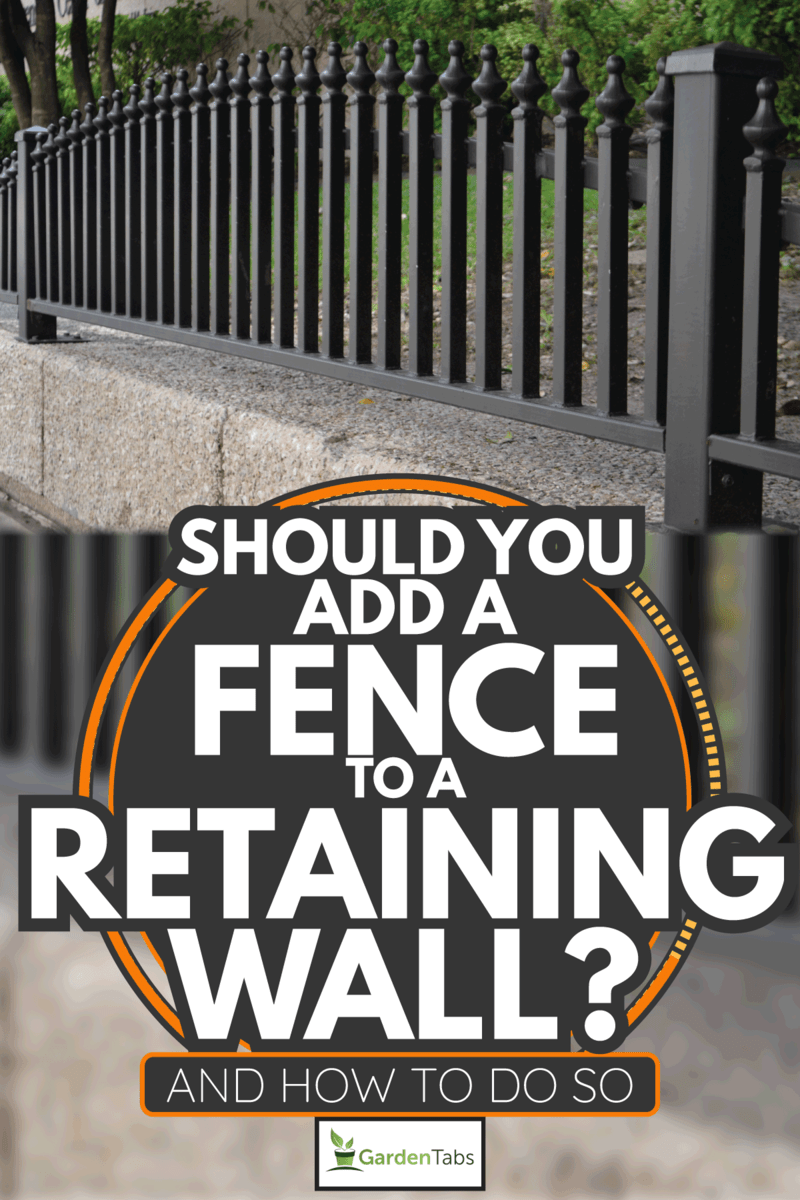 Iron Fence which protects an elevated garden lot. Should You Add A Fence To A Retaining Wall [And How To Do So]