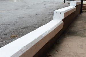 Read more about the article Can You Build A Retaining Wall On Concrete? [Plus How-To Tips]