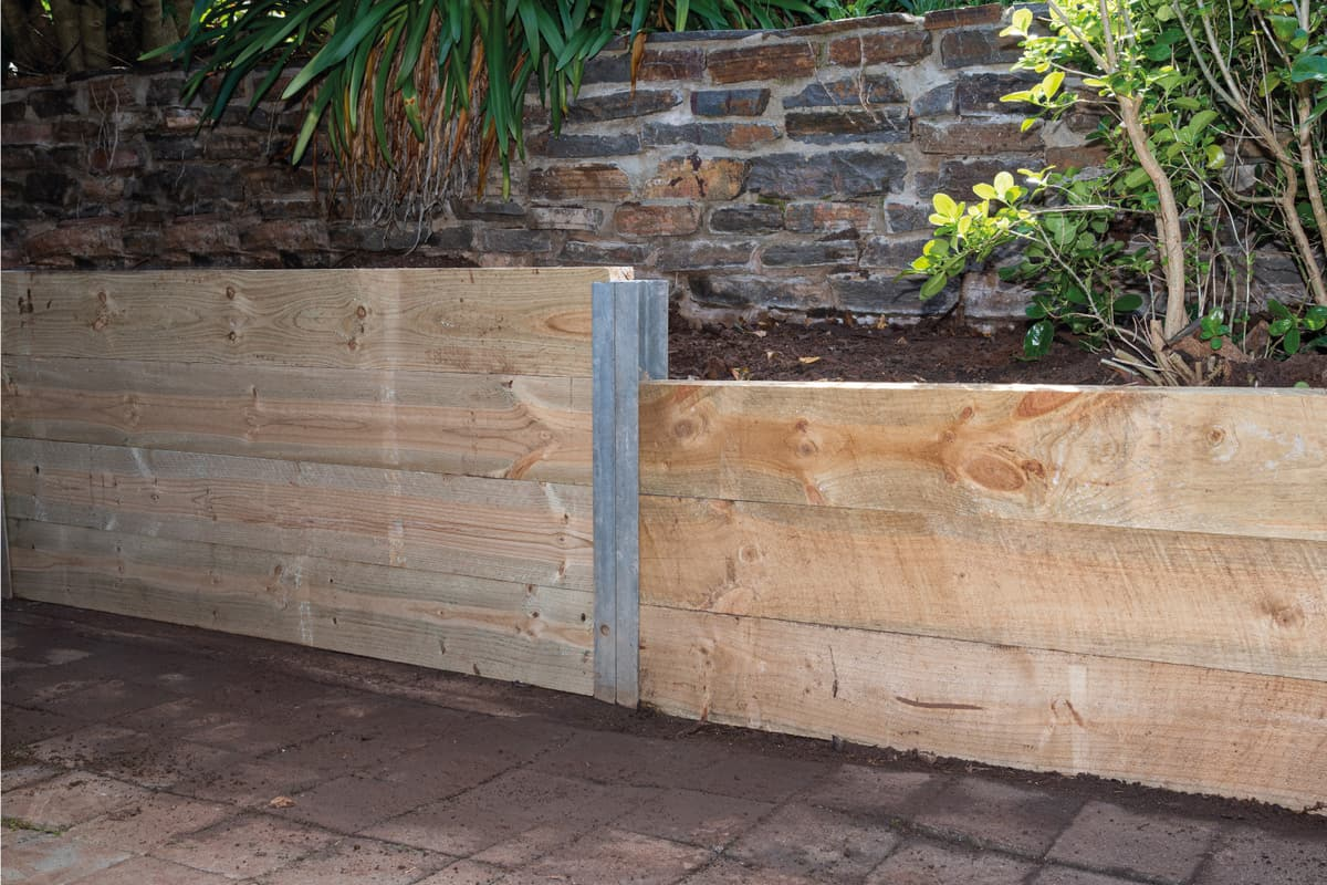 Retaining Wall, bulit with pressure treated Structural Pine, terraced garden beds.